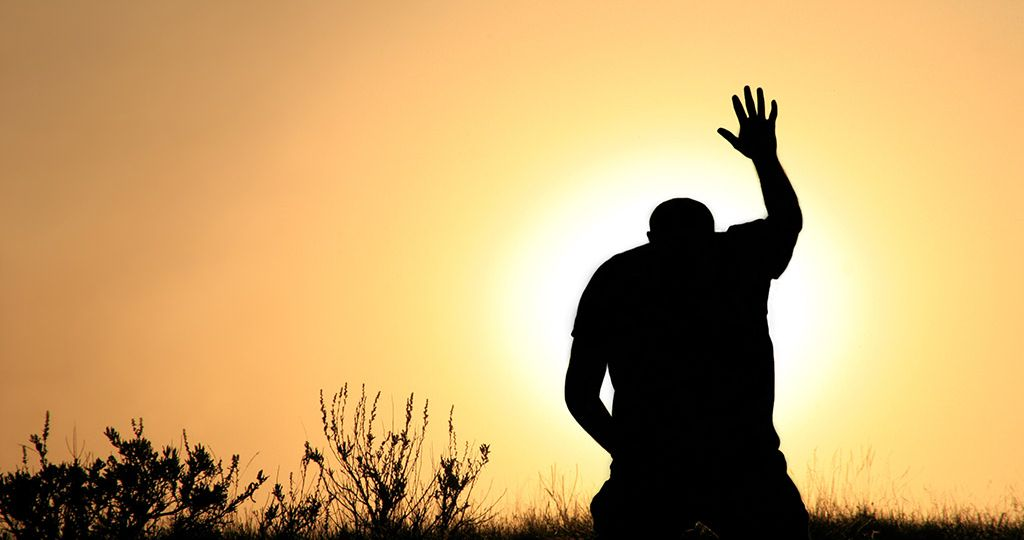 Silhouette of Man In Praise and Worship