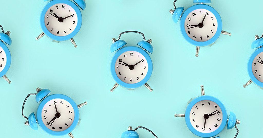 Full Frame Shot Of Alarm Clocks On Table